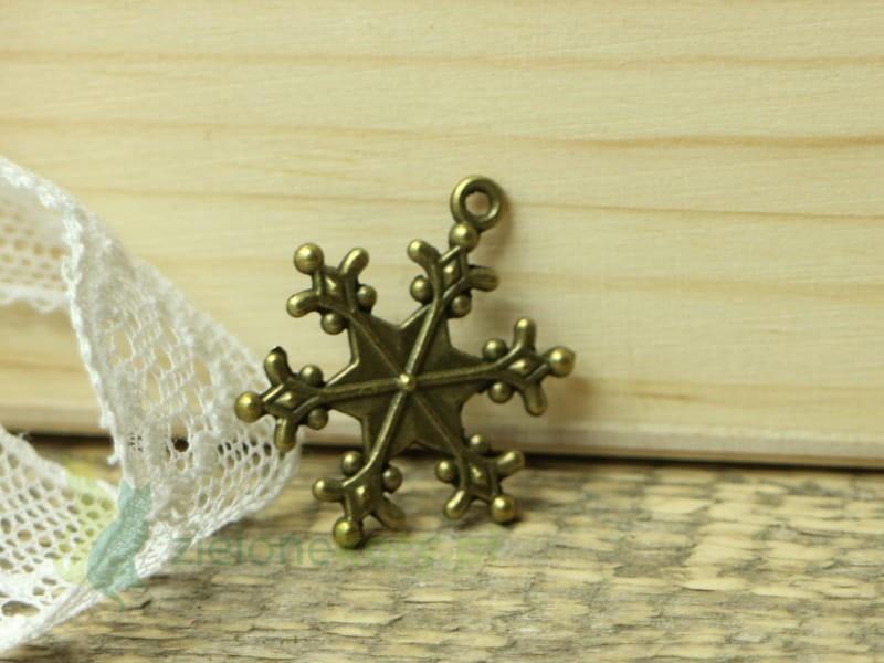 http://zielonekoty.pl/pl/p/zawieszka-metal-sniezynka-2%2C4cm-braz/818